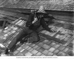 Frank Bonds shingling a roof, Sumas, September 4, 1909
