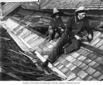 Frank and Fred Bonds shingling a roof, Sumas, 1908
