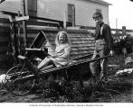 Fred with Lorene Bonds in wheelbarrow, Sumas, 1908