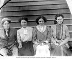 Sumas High School seniors (Frank Bonds and three girls) on porch, October, 1909