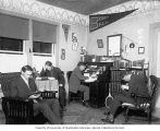 Four young men studying in Linfield College dormitory room, McMinnville, 1909