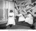 Three young women studying in McMinnville College dormitory room, McMinnville, Oregon, 1909