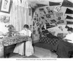 Three young women studying in McMinnville College dormitory room, McMinnville, 1909