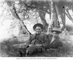 Frank Bonds and Ira Bright relaxing under some trees, June 7, 1908