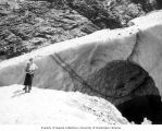 Mildred Powell and Douglas Welch, of the Seattle Post-Intelligencer, at the ice caves at Big Four...