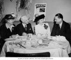 City Council group gathering at a meal including Mildred Powell, Frank Laube, and M.B. Mitchell,...