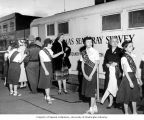 Girl Scouts from Troop 31 standing in front of x-ray truck, Pierce County Tuberculosis League...