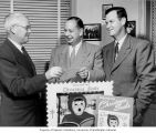 Frank Walters, Paul Newman, and Dr. Louis Hayer exchanging a Christmas Seals check, Pierce County...