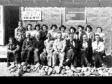 Group in front of housing office, Minidoka Relocation Center, ca. 1943-1945