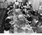 People at long table making Christmas ornaments, Junior Board of the Pierce County Tuberculosis...