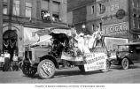 Anti-Tuberculosis League of Pierce County members riding on back of truck in a July 4th parade,...
