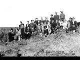 Group of men and women on a hillside, Minidoka Relocation Center, ca. 1943-1945