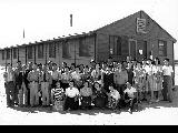 Group in front of Co-op stores, Minidoka Relocation Center, ca. 1943-1945