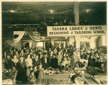 Japanese women and children standing in large room at the Tanaka School of Dressmaking, Seattle,...