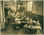 Young Japanese women working at sewing machines at the Tanaka School of Dressmaking, Seattle,...