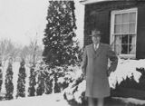Dr. Howard Hull standing outside in snow, Oakhurst Sanitorium, Elma, 1948