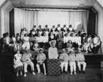 Group on stage with people in black face, Seattle Civic Opera-Moonlight Cabaret Minstrels, 1951