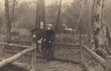 Esther Stark Maltby standing on a forest path next to a man, possibly H.E. Maltby, with an...