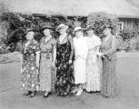 Group of women from the Washington State and Seattle Federation of Women's Clubs standing on lawn...
