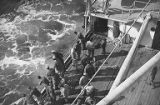 Soldiers on deck of the ship that Loren Thrush was on when returning from Army service in the...