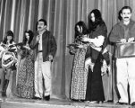 Sally Cantu and five other people on stage during a performance of the Teatro del Piojo, U.S....