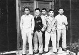Japanese men posing outside of building, probably at the Tule Lake Relocation Center, California,...