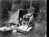 Automobile camping showing car, tent and two people picnicking at Silver Lake,  1920