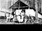 Campers outside of cabin, location unknown, n.d.