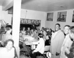 King Neptune, E. L. Blaine Jr., and Seafair Royalty entertaining guests at a local restaurant,...