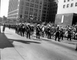 Band marching down 4th Ave. near James St. in downtown Seattle during the Seafair parade, August...