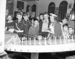 Boys playing a carnival game with members of the American Legion Cathay Post 186 during the...