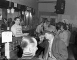 Bartenders at Barney's Cafe serving and socializing with patrons, 1532 7th Ave., Seattle, ca. 1952
