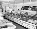 Employees of the Belmont Food Market standing behind the meat counter, 506 Main St., Seattle, July...