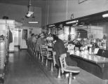 Men sitting at the counter of the Maynard Cafe, 417 Maynard Ave., Seattle, ca. 1950's