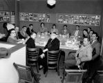 Friends sitting and dining at the Victory Cafe, 2403 1st. Ave. S, Seattle, 1951