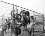 Mostly African-American and Asian-American children playing on a school playground, Seattle, 1951