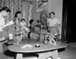 Japanese-American artist George Tsutakawa sitting with his wife, two young children and a friend...