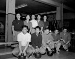 Asian-American bowling team posing for a group photograph, probably at the Main Bowl, Seattle, ca....