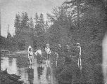 Mazama Club members standing barelegged and ankle-deep in lake on an outing to Mount Rainier, 1902