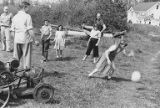 Family  members playing with volleyball at Hogenauer and Gourley family picnic, ca. 1945