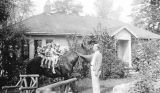 Five children on horse in front yard, September 5, 1936