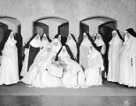 Cast costumed as nuns in scene from the play, The Cradle Song at the Civic Repertory Theatre, New...