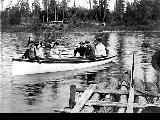 Group of men and women on a boating excursion, location unknown, n.d.