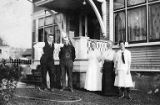Arthur Nottingham and other family members in front of house, probably in La Crosse, Wisconsin,...