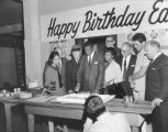 Fans of local boxer Eddie Cotton cutting a cake in celebration of Mr. Cotton's birthday, June 15,...