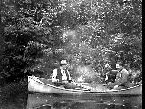 Two men fishing from rowboat, location unknown, n.d.