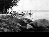 Women and children sitting in a rowboat, Lake Washington, 1900