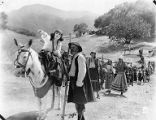 Pola Negri leading a caravan from a scene in The Spanish Dancer, 1923