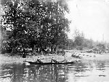 Mr. Blaine. Mrs. Thompson and Miss Penfield in canoe with older women and children on shore in...