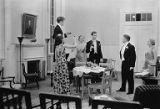 Actors and scene from Philip Barry's comedy Holiday  showing actors toasting around a table